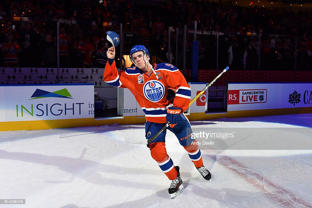 Connor McDavid #97 of the Edmonton Oilers salutes the fans after being selected the first star of the game following the season opener against the Calgary Flames on October 12, 2016 at Rogers Place in Edmonton, Alberta, Canada