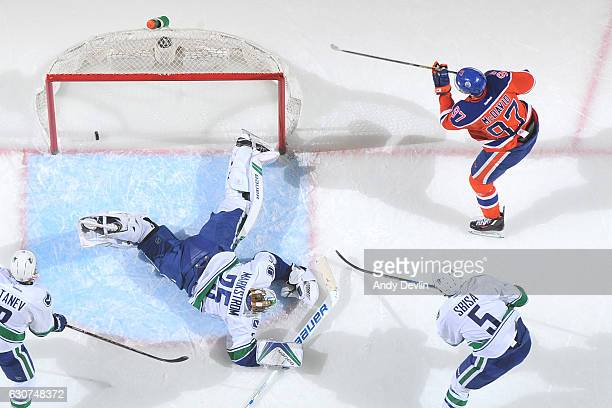 Connor McDavid of the Edmonton Oilers scores a goal on Jacob Markstrom of the Vancouver Canucks on December 31 2016 at Rogers Place in Edmonton...