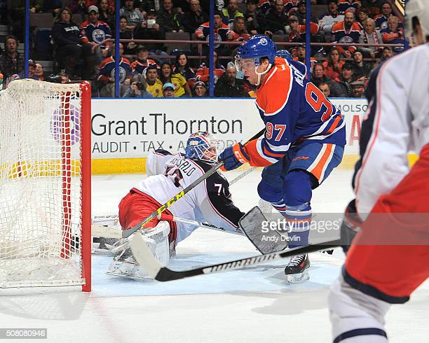 Connor McDavid of the Edmonton Oilers scores a goal on Joonas Korpisalo of the Columbus Blue Jackets on February 2 2016 at Rexall Place in Edmonton...