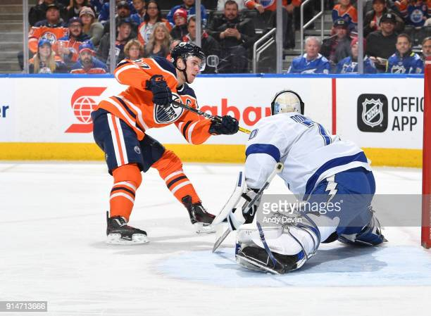 Connor McDavid of the Edmonton Oilers scores a goal on Louis Domingue of the Tampa Bay Lightning on February 5 2018 at Rogers Place in Edmonton...