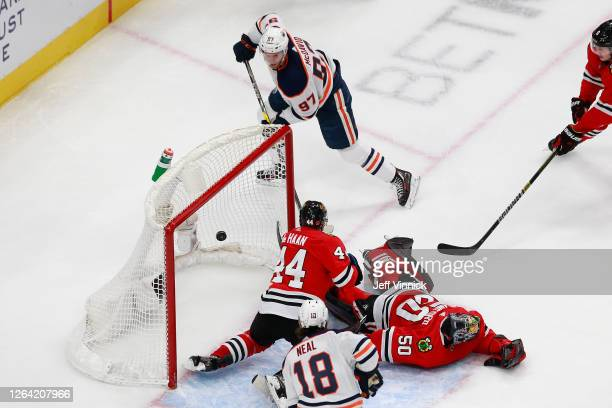 Connor McDavid of the Edmonton Oilers scores a goal past Corey Crawford of the Chicago Blackhawks during the second period in Game Three of the...
