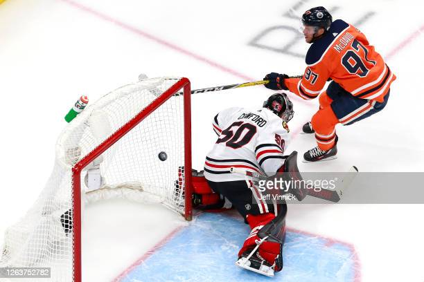 Connor McDavid of the Edmonton Oilers scores his second goal against Corey Crawford of the Chicago Blackhawks during the first period in Game Two of...