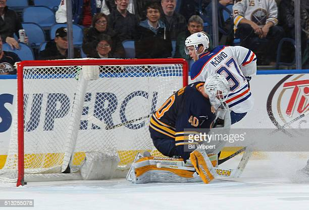 Connor McDavid of the Edmonton Oilers scores the game winning overtime goal against Robin Lehner of the Buffalo Sabres during an NHL game on March 1...