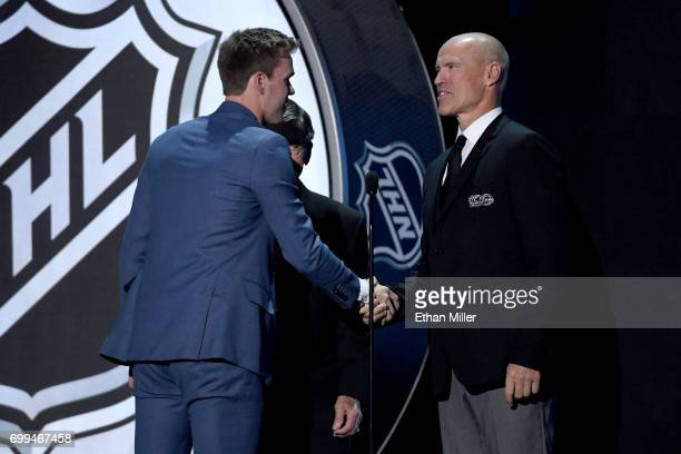 Connor McDavid of the Edmonton Oilers shakes hands with Mark Messier after winning the Ted Lindsay Award during the 2017 NHL Awards and Expansion...