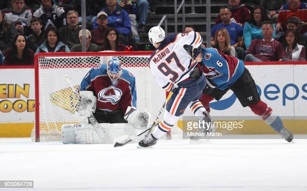 07299de5dee Connor McDavid of the Edmonton Oilers shoots against Erik Johnson and  goaltender Semyon Varlamov the Colorado