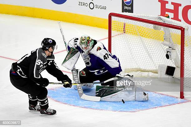 Connor McDavid of the Edmonton Oilers shoots the puck against Devan Dubnyk of the Minnesota Wild during the 2017 Honda NHL AllStar Game Semifinal at...