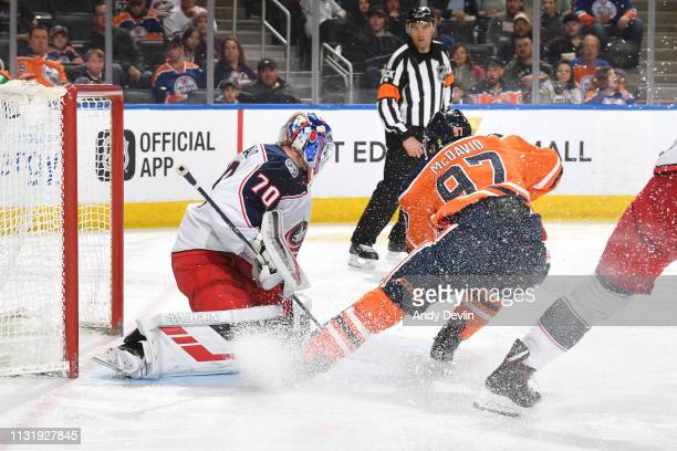 Connor McDavid of the Edmonton Oilers shoots the puck on Joonas Korpisalo of the Columbus Blue Jackets on March 21 2019 at Rogers Place in Edmonton...