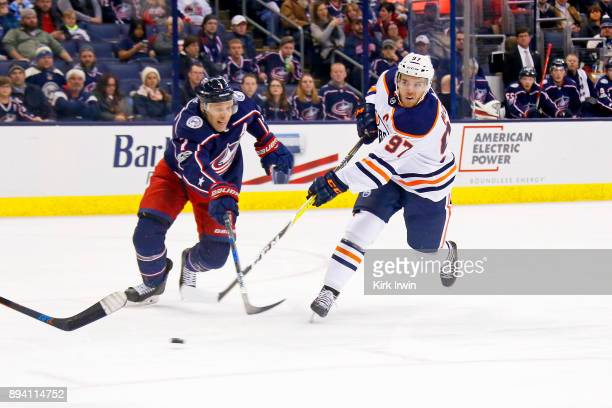 Connor McDavid of the Edmonton Oilers shoots the puck past Jack Johnson of the Columbus Blue Jackets during the game on December 12 2017 at...