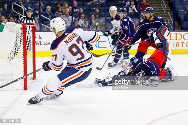 Connor McDavid of the Edmonton Oilers shoots the puck past Joonas Korpisalo of the Columbus Blue Jackets for a goal on December 12 2017 at Nationwide...
