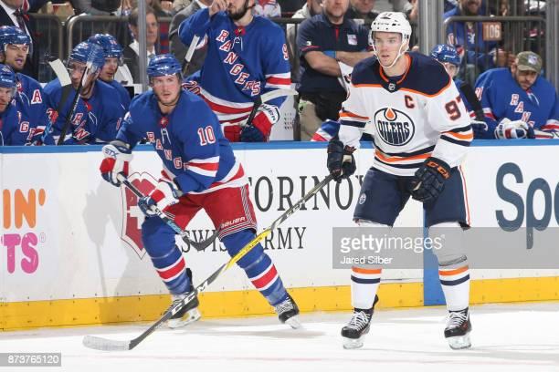 Connor McDavid of the Edmonton Oilers skates against JT Miller of the New York Rangers at Madison Square Garden on November 11 2017 in New York City...