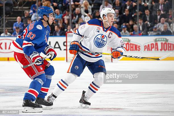 Connor McDavid of the Edmonton Oilers skates against Mika Zibanejad of the New York Rangers at Madison Square Garden on November 3 2016 in New York...