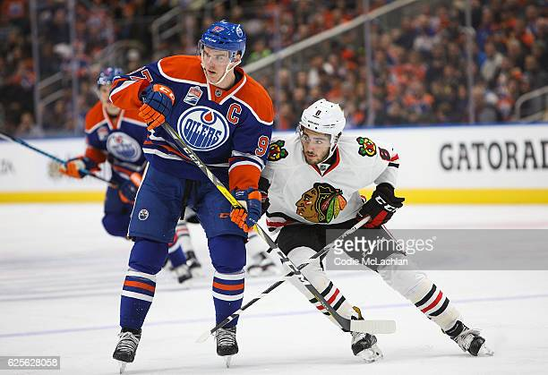 Connor McDavid of the Edmonton Oilers skates against Nick Schmaltz of the Chicago Blackhawks on November 21 2016 at Rogers Place in Edmonton Alberta...