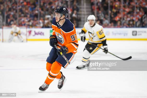 Connor McDavid of the Edmonton Oilers skates against Sidney Crosby of the Pittsburgh Penguins at Rogers Place on November 1 2017 in Edmonton Canada
