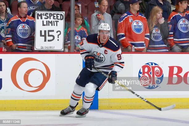 Connor McDavid of the Edmonton Oilers skates past fans before his NHL game against the Vancouver Canucks at Rogers Arena October 7 2017 in Vancouver...