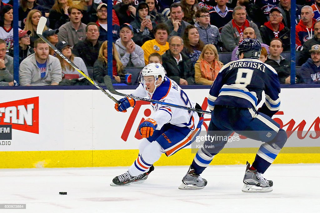 Connor McDavid #97 of the Edmonton Oilers skates the puck around Zach Werenski #8 of the Columbus Blue Jackets during the third period on January 3, 2017 at Nationwide Arena in Columbus, Ohio. Columbus defeated Edmonton 3-1 to win their 16th consecutive game.