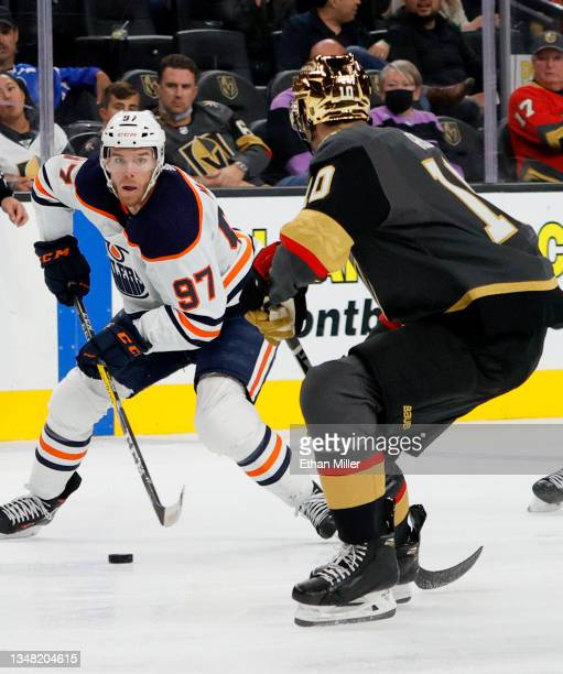 Connor McDavid of the Edmonton Oilers skates with the puck against Nicolas Roy of the Vegas Golden Knights in the third period of their game at...