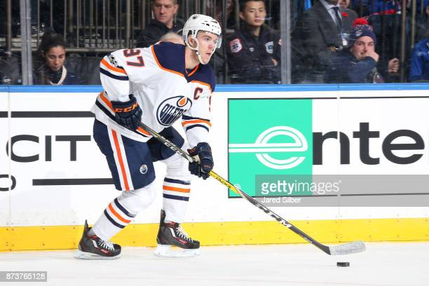 Connor McDavid of the Edmonton Oilers skates with the puck against the New York Rangers at Madison Square Garden on November 11 2017 in New York City...
