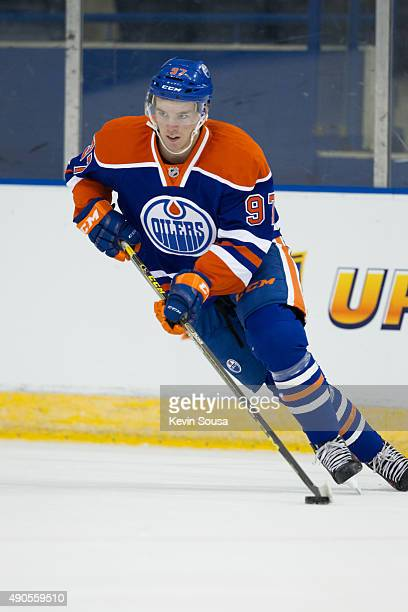Connor McDavid of the Edmonton Oilers skates with the puck during a photo shoot at the 2015 NHLPA Rookie Showcase at Mattamy Athletic Centre on...