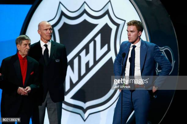 Connor McDavid of the Edmonton Oilers speaks onstage after being awarded the Ted Lindsay Award as Ted Lindsay and Mark Messier look on during the...