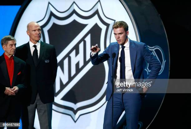 Connor McDavid of the Edmonton Oilers speaks onstage as Ted Lindsay and Mark Messier look on during the 2017 NHL Awards Expansion Draft at TMobile...