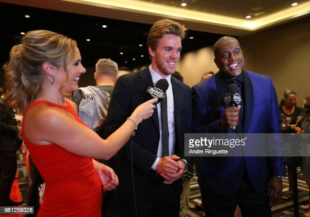 Connor McDavid of the Edmonton Oilers speaks with NHL Network sportscasters Jamie Hersch and Kevin Weekes as McDavid arrives at the 2018 NHL Awards...