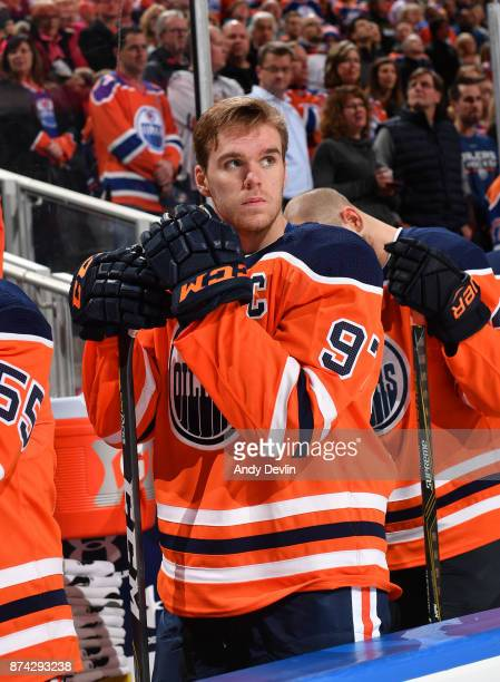 Connor McDavid of the Edmonton Oilers stands for the singing of the national anthem prior to the game against the Vegas Golden Knights on November 14...