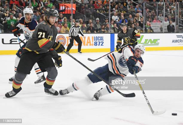 Connor McDavid of the Edmonton Oilers steals the puck from William Karlsson of the Vegas Golden Knights in the second period of their game at TMobile...