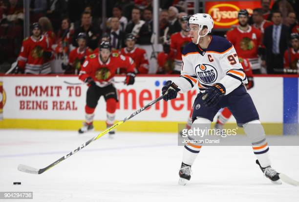 Connor McDavid of the Edmonton Oilers takes a pass against the Chicago Blackhawks at the United Center on January 7 2018 in Chicago Illinois The...