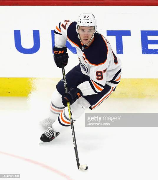 Connor McDavid of the Edmonton Oilers turns to pass the puck against the Chicago Blackhawks at the United Center on January 7 2018 in Chicago...