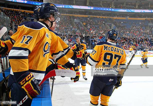 Connor McDavid of the Erie Otters celebrates a goal against the Niagara IceDogs in an OHL hockey game at the First Niagara Center on October 22 2014...