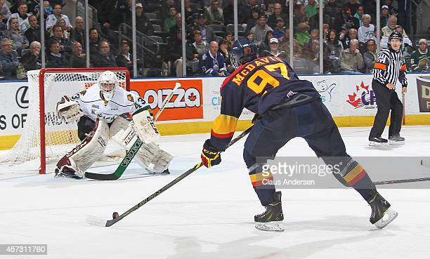 Connor McDavid of the Erie Otters gets set to fire a shot at Michael Giugovaz of the London Knights in an OHL game at the Budweiser Gardens on...
