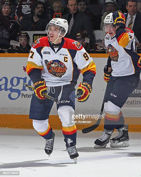 Connor McDavid of the Erie Otters smiles after scoring a goal in an OHL game against the Peterborough Petes at the Peterborough Memorial Centre on...