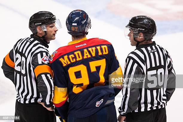 Connor McDavid of the Erie Otters speaks with referees between plays against the Windsor Spitfires on September 26 2014 at the WFCU Centre in Windsor...