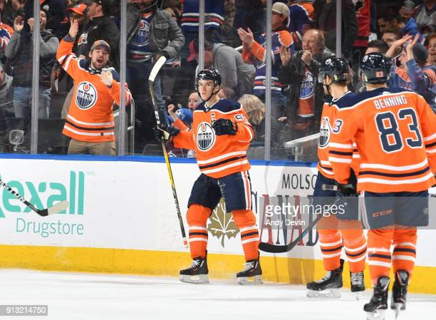Connor McDavid Oscar Klefbom and Matthew Benning of the Edmonton Oilers celebrate after a goal during the game against the Colorado Avalanche on...