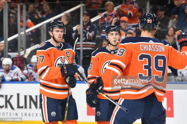 Connor McDavid Ryan NugentHopkins and Alex Chiasson of the Edmonton Oilers celebrate after a goal during the game against the New York Rangers on...