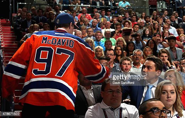 Connor McDavid shakes hands with Dylan Strome after being selected first overall by the Edmonton Oilers during Round One of the 2015 NHL Draft at BBT...