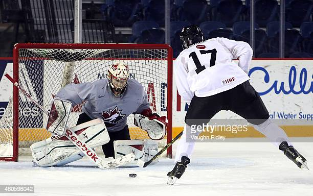Connor McDavid shoots on Zachary Fucale during the Canada National Junior Team practice at the Meridian Centre on December 17 2014 in St Catharines...