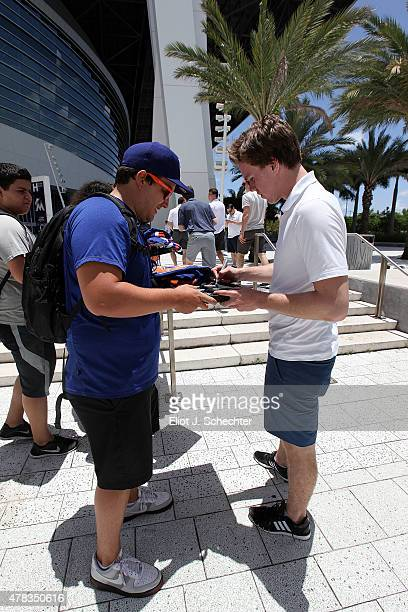 Connor McDavid the 2015 NHL Top Draft Prospect signs autographs for fans while on the Media Tour at Marlins Park on June 24 2015 in Miami Florida