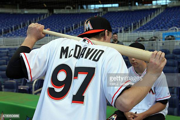 Connor McDavid the 2015 NHL Top Draft Prospect stretches with a baseball bat while on the Media Tour for batting practice at Marlins Park on June 24...