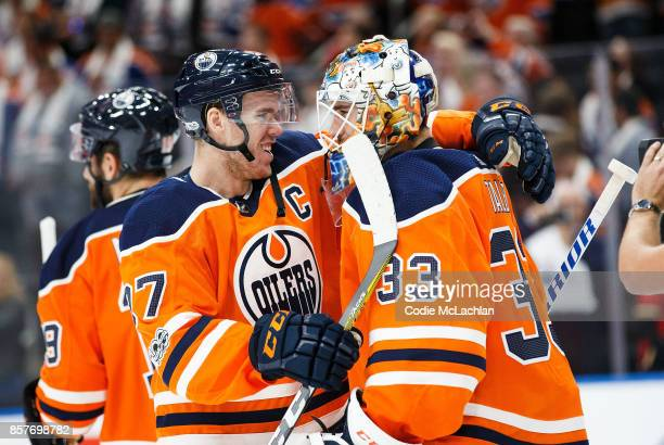 Connor McDavid who had a hat trick celebrates with goaltender Cam Talbot of the Edmonton Oilers who posted a shutout against the Calgary Flames at...