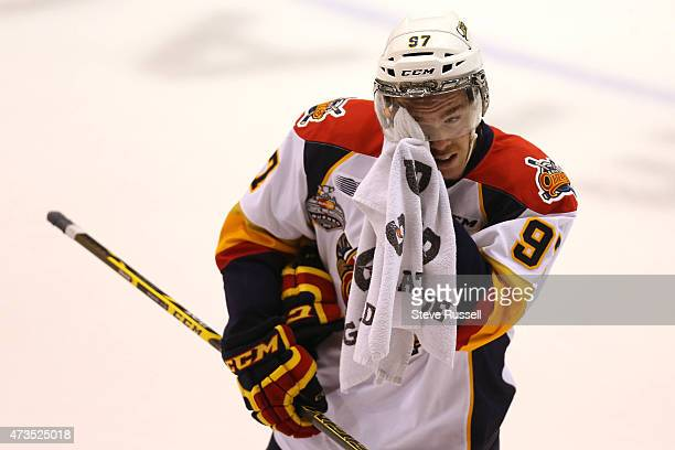 Connor McDavid wipes his visor during a break in play as the Oshawa Generals play the Erie Otters in what may be Connor McDavid's, the top NHL...