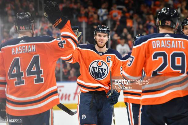 Connor McDavid Zack Kassian and Leon Draisaitl of the Edmonton Oilers celebrate after a goal during the game against the Columbus Blue Jackets on...