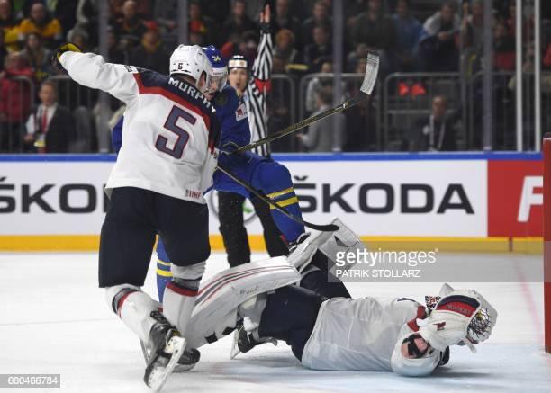 US Connor Murphy goalkeeper Jimmy Howard and Sweden´s Anton Stralmann vie during the IIHF Ice Hockey World Championships first round match between...