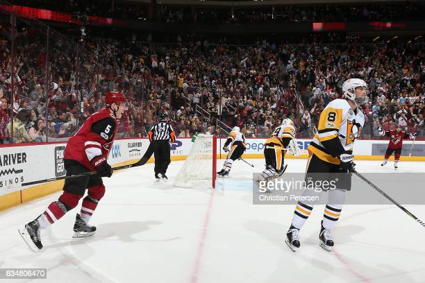 Connor Murphy of the Arizona Coyotes celebrates after scoring the game winning goal against the Pittsburgh Penguins in overtime of the NHL game at...