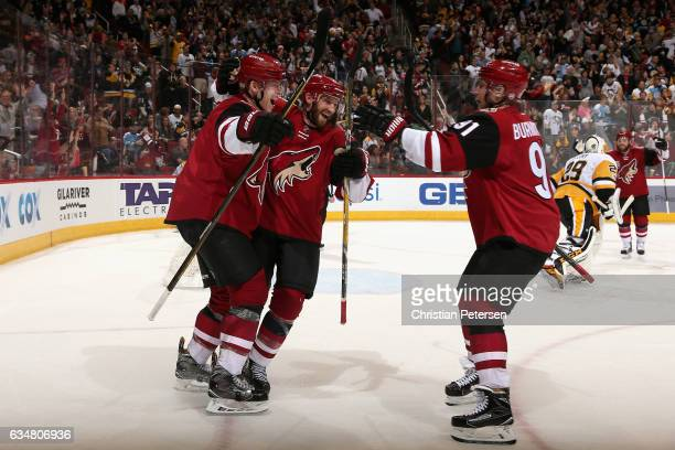 Connor Murphy of the Arizona Coyotes celebrates with Alex Goligoski and Alexander Burmistrov after scoring the game winning goal against the...