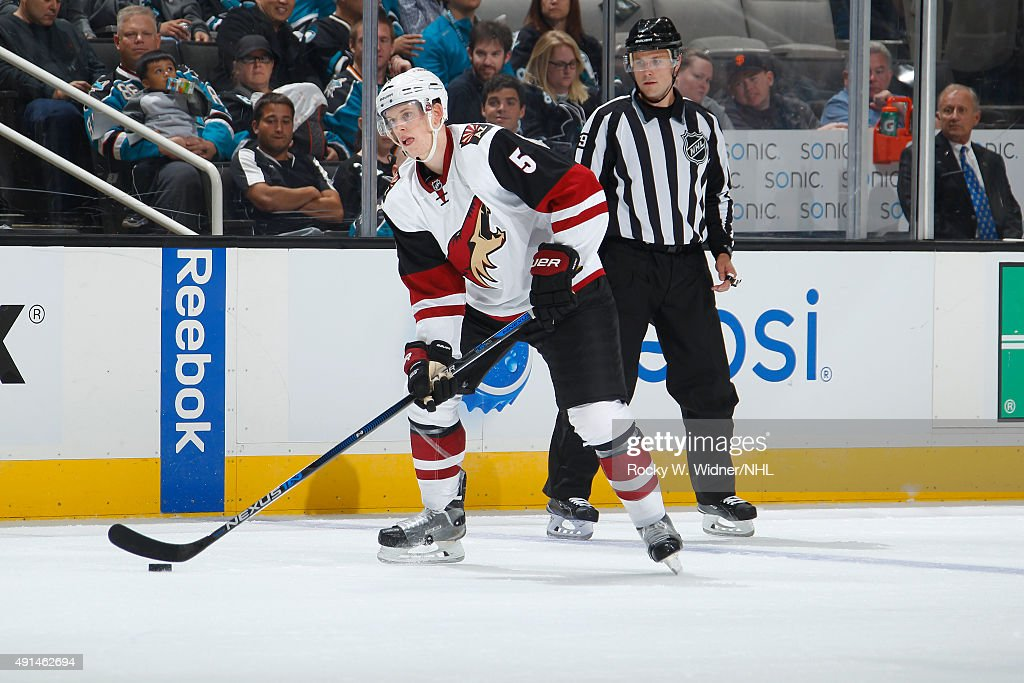 Connor Murphy #5 of the Arizona Coyotes skates with control of the puck against the San Jose Sharks at SAP Center on September 25, 2015 in San Jose, California.