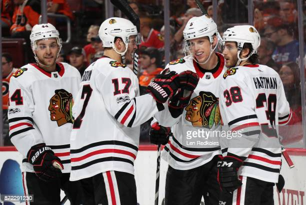 Connor Murphy of the Chicago Blackhawks celebrates his second period goal against the Philadelphia Flyers with teammates Jan Rutta Lance Bouma and...
