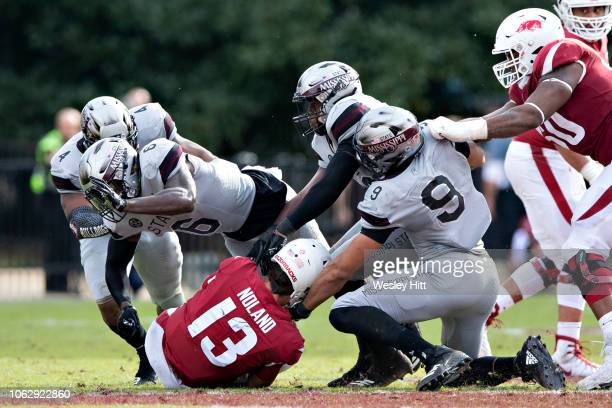 Connor Noland of the Arkansas Razorbacks is sacked in the second half of a game by Montez Sweat and Willie Gay Jr #6 of the Mississippi State...