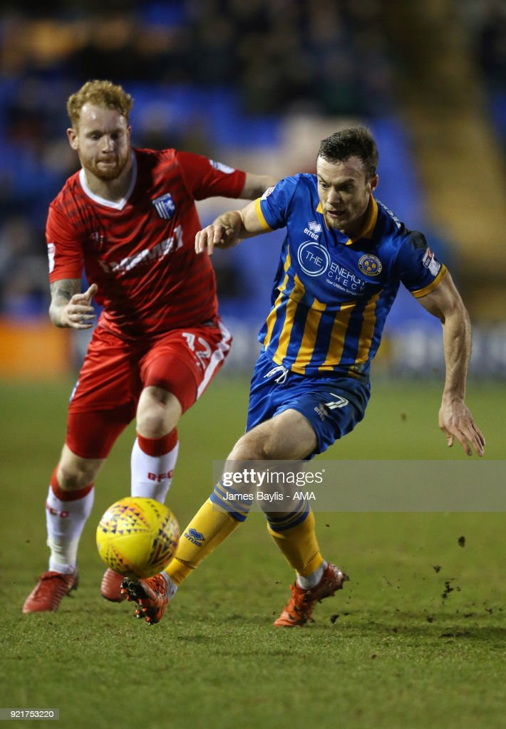 Connor Ogilvie of Gillingham and Shaun Whalley of Shrewsbury Town during the Sky Bet League One match between Shrewsbury Town and Gillingham at New Meadow on February 20, 2018 in Shrewsbury, England.