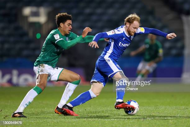 Connor Ogilvie of Gillingham FC battles for possession with Morgan Rogers of Lincoln City during the Sky Bet League One match between Gillingham and...